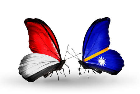 Two butterflies with flags on wings as symbol of relations Monaco, Indonesia and Nauru photo