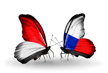 Two butterflies with flags on wings as symbol of relations Monaco, Indonesia and Chile photo