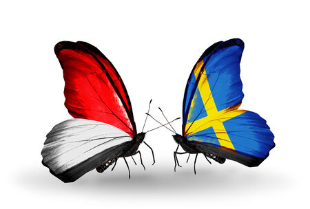 Two butterflies with flags on wings as symbol of relations Monaco, Indonesia and  Sweden photo