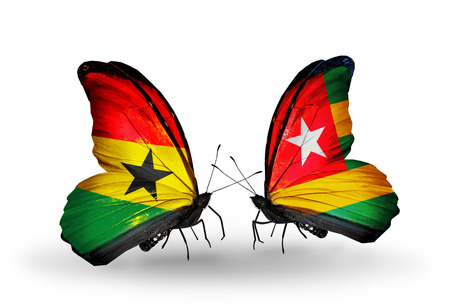 Two butterflies with flags on wings as symbol of relations Ghana and  Togo photo