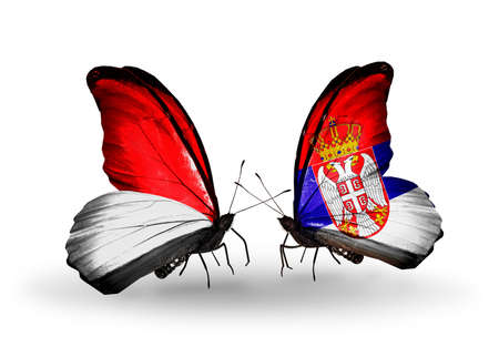 Two butterflies with flags on wings as symbol of relations Monaco, Indonesia and Serbia photo