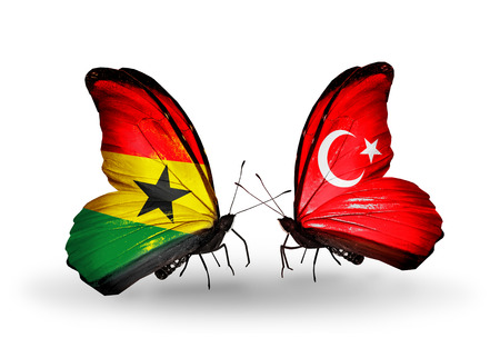 Two butterflies with flags on wings as symbol of relations Ghana and Turkey photo