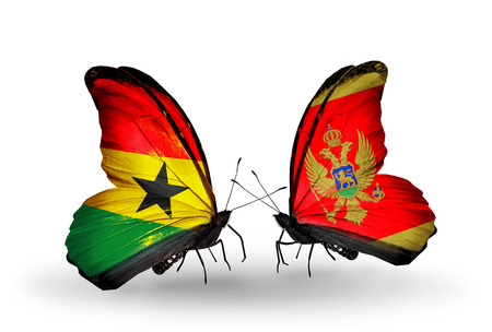 Two butterflies with flags on wings as symbol of relations Ghana and Montenegro photo