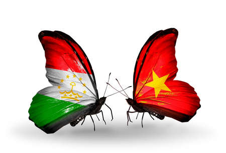 economy of tajikistan: Two butterflies with flags on wings as symbol of relations Tajikistan and Vietnam