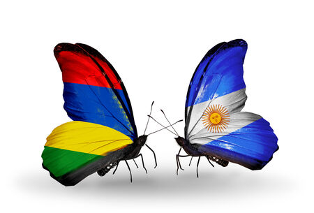 Two butterflies with flags on wings as symbol of relations Mauritius and Argentina photo