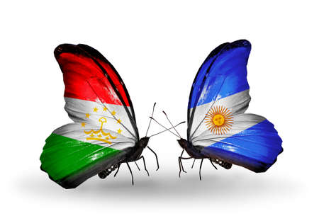 economy of tajikistan: Two butterflies with flags on wings as symbol of relations Tajikistan and Argentina Stock Photo