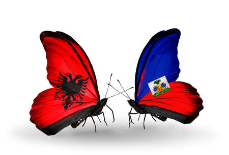 Two butterflies with flags on wings as symbol of relations Albania and Haiti photo