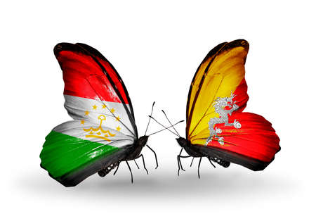 economy of tajikistan: Two butterflies with flags on wings as symbol of relations Tajikistan and Bhutan