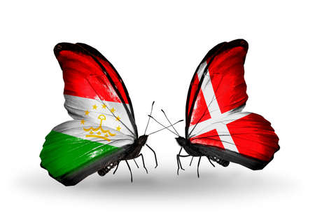 economy of tajikistan: Two butterflies with flags on wings as symbol of relations Tajikistan and Denmark