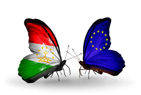 economy of tajikistan: Two butterflies with flags on wings as symbol of relations Tajikistan and European Union