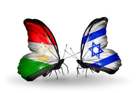 economy of tajikistan: Two butterflies with flags on wings as symbol of relations Tajikistan and Israel Stock Photo