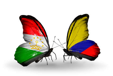 economy of tajikistan: Two butterflies with flags on wings as symbol of relations Tajikistan and Columbia Stock Photo