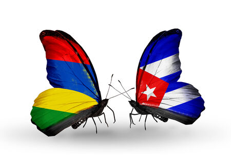 Two butterflies with flags on wings as symbol of relations Mauritius and Cuba Stock Photo