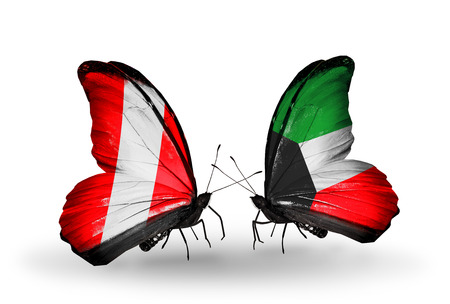 Two butterflies with flags on wings as symbol of relations Peru and Kuwait photo