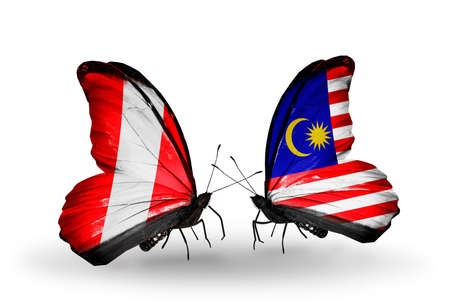 Two butterflies with flags on wings as symbol of relations Peru and Malaysia photo