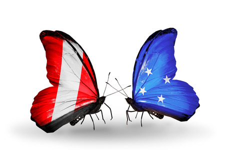Two butterflies with flags on wings as symbol of relations Peru and Micronesia photo