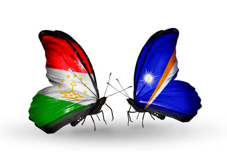 economy of tajikistan: Two butterflies with flags on wings as symbol of relations Tajikistan and Marshall islands