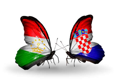 economy of tajikistan: Two butterflies with flags on wings as symbol of relations Tajikistan and Croatia Stock Photo
