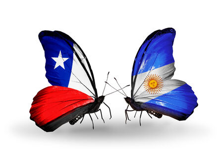 Two butterflies with flags on wings as symbol of relations Chile and Argentina photo