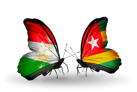 economy of tajikistan: Two butterflies with flags on wings as symbol of relations Tajikistan and Togo Stock Photo