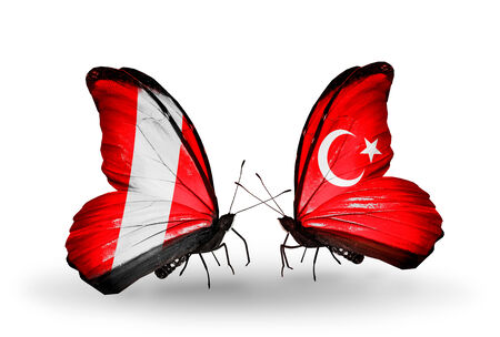 Two butterflies with flags on wings as symbol of relations Peru and Turkey photo