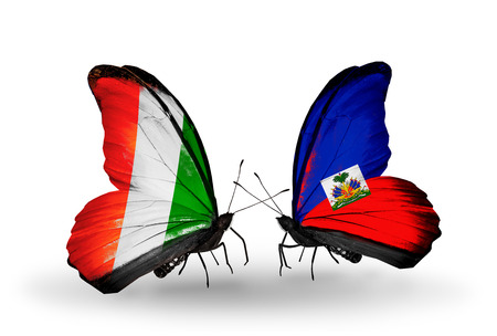 Two butterflies with flags on wings as symbol of relations Cote Divoire and Haiti photo