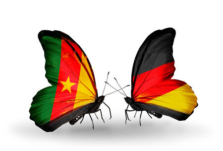 Two butterflies with flags on wings as symbol of relations Cameroon and Germany photo
