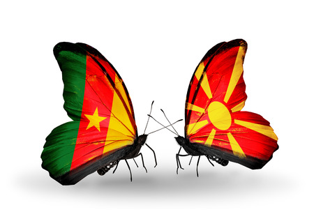 Two butterflies with flags on wings as symbol of relations Cameroon and Macedonia photo