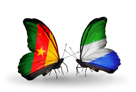 Two butterflies with flags on wings as symbol of relations Cameroon and Sierra Leone photo