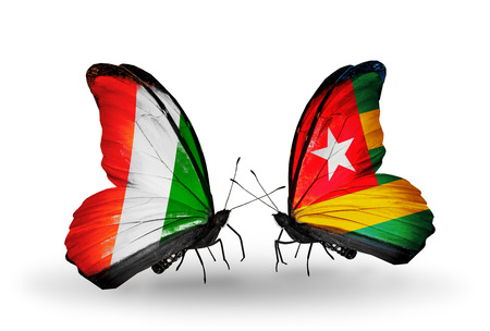 Two butterflies with flags on wings as symbol of relations Cote Divoire and  Togo photo