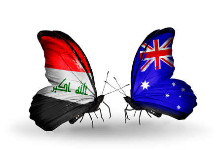 iraq money: Two butterflies with flags on wings as symbol of relations Iraq and  Australia Stock Photo