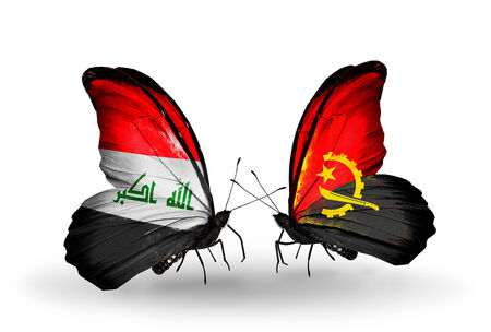 iraq money: Two butterflies with flags on wings as symbol of relations Iraq and  Angola Stock Photo