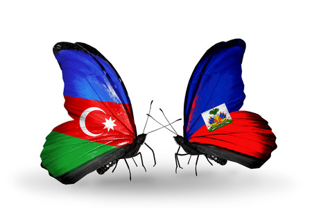 Two butterflies with flags on wings as symbol of relations Barbados and Haiti photo