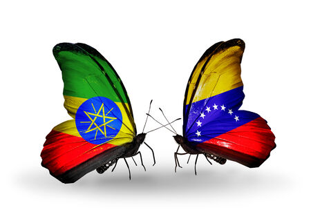 Two butterflies with flags on wings as symbol of relations Ethiopia and Venezuela photo