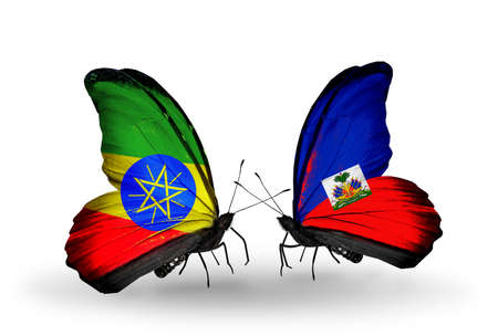 Two butterflies with flags on wings as symbol of relations Ethiopia and Haiti photo