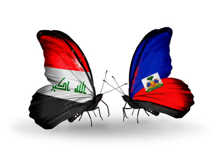 Two butterflies with flags on wings as symbol of relations Iraq and  Haiti photo