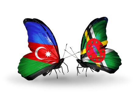 Two butterflies with flags on wings as symbol of relations Azerbaijan and Dominica photo
