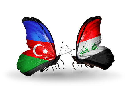iraq money: Two butterflies with flags on wings as symbol of relations Azerbaijan and Iraq Stock Photo