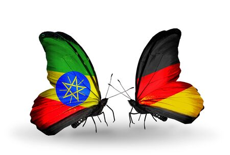 Two butterflies with flags on wings as symbol of relations Ethiopia and Germany photo