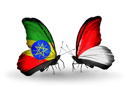 Two butterflies with flags on wings as symbol of relations Ethiopia and Monaco, Indonesia photo
