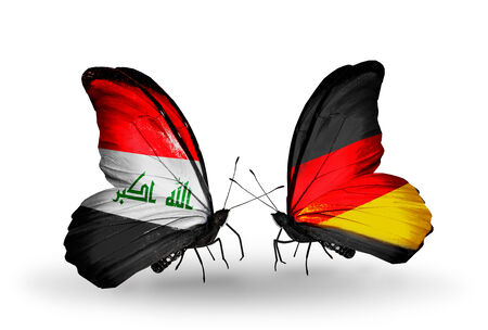 iraq money: Two butterflies with flags on wings as symbol of relations Iraq and Germany