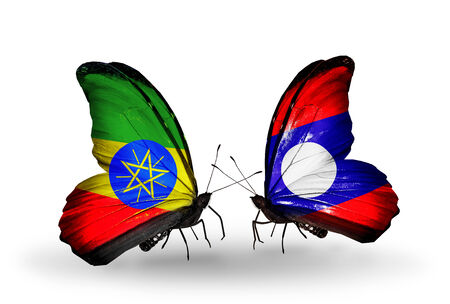Two butterflies with flags on wings as symbol of relations Ethiopia and Laos photo
