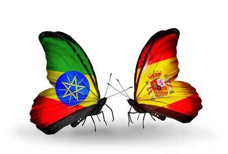 Two butterflies with flags on wings as symbol of relations Ethiopia and Spain photo