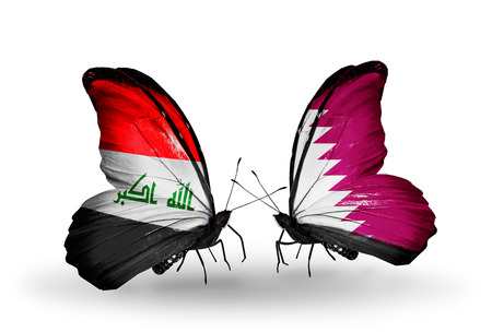 iraq money: Two butterflies with flags on wings as symbol of relations Iraq and Qatar Stock Photo