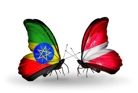 Two butterflies with flags on wings as symbol of relations Ethiopia and Latvia photo