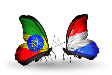 Two butterflies with flags on wings as symbol of relations Ethiopia and Luxembourg photo