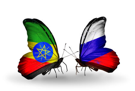 Two butterflies with flags on wings as symbol of relations Ethiopia and  Russia photo