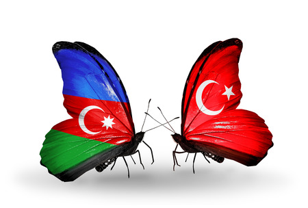 Two butterflies with flags on wings as symbol of relations Azerbaijan and Turkey photo