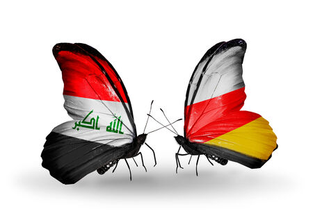 iraq money: Two butterflies with flags on wings as symbol of relations Iraq and South Ossetia Stock Photo