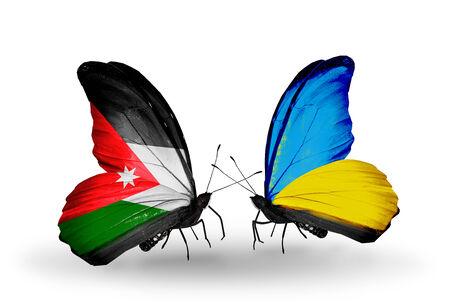 emblem of ukraine: Two butterflies with flags on wings as symbol of relations Jordan and Ukraine